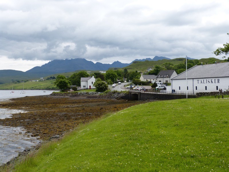 Explore the Isle of Skye including the historic Dunvegan Castle and the Talisker Distillery on the edge of the dramatic Cuillins image